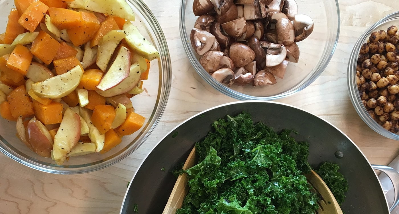 bowls of kale, mushrooms, and potatoes